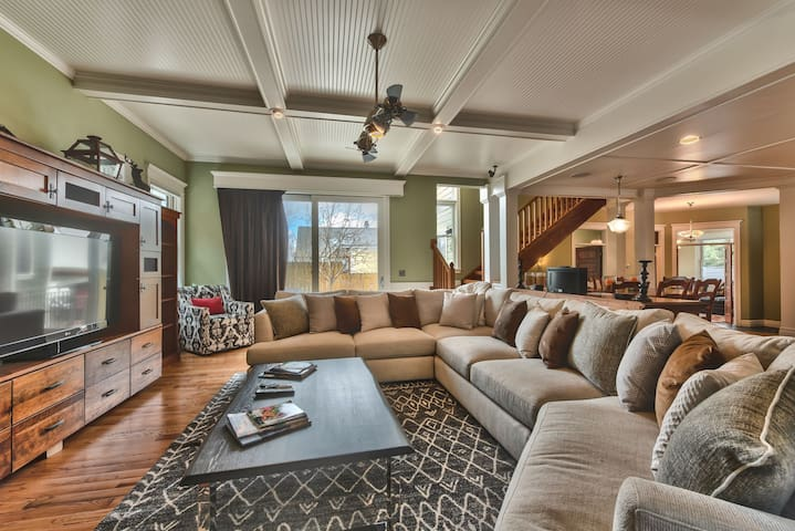 Living Room With Large Sectional, Flat Screen TV, Gas Fireplace and Patio Access