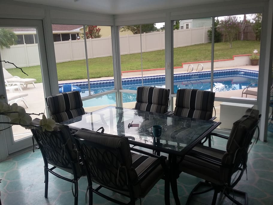 large screened-in patio area + big swimming pool