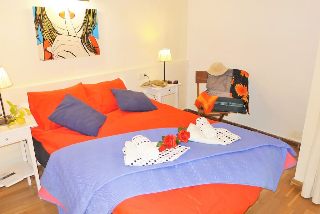 bedroom: double bed, bedside tables, wardrobe, en suite.