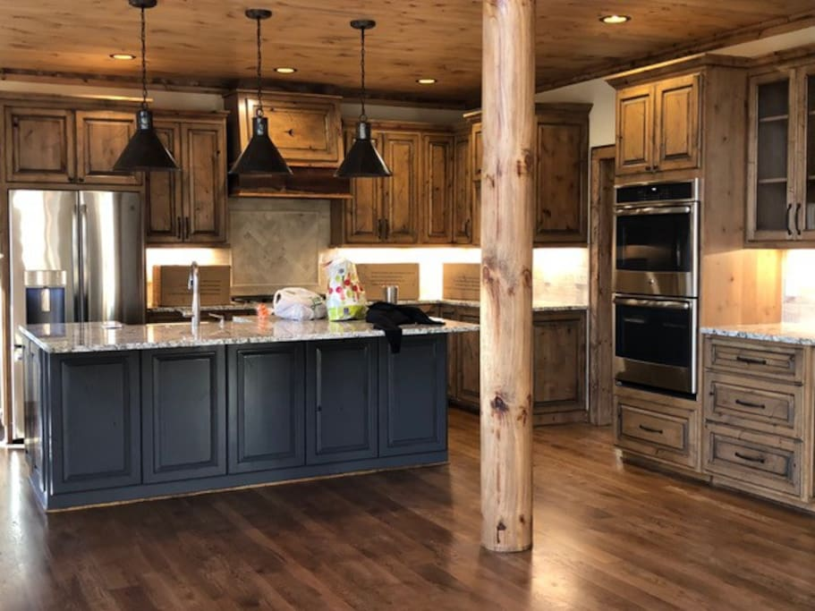 This spacious kitchen has a layout planned for visitors.