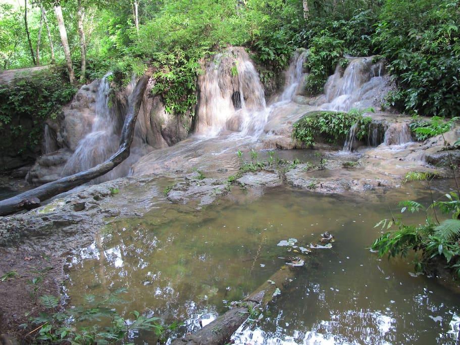 beautiful swimming and waterfall right beside the ashram