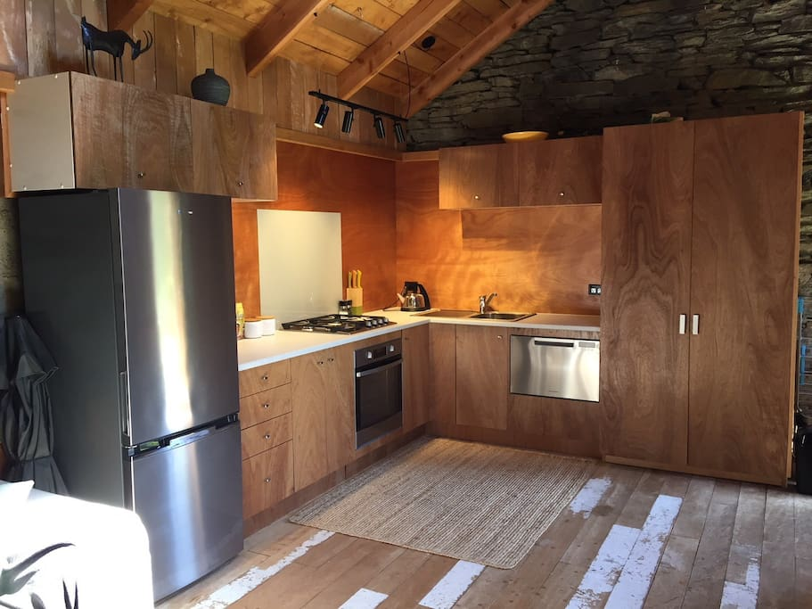 Room 2: Fully equipped kitchen with new appliances, full sized fridge/freezer, oven, gas hobs and dishwasher