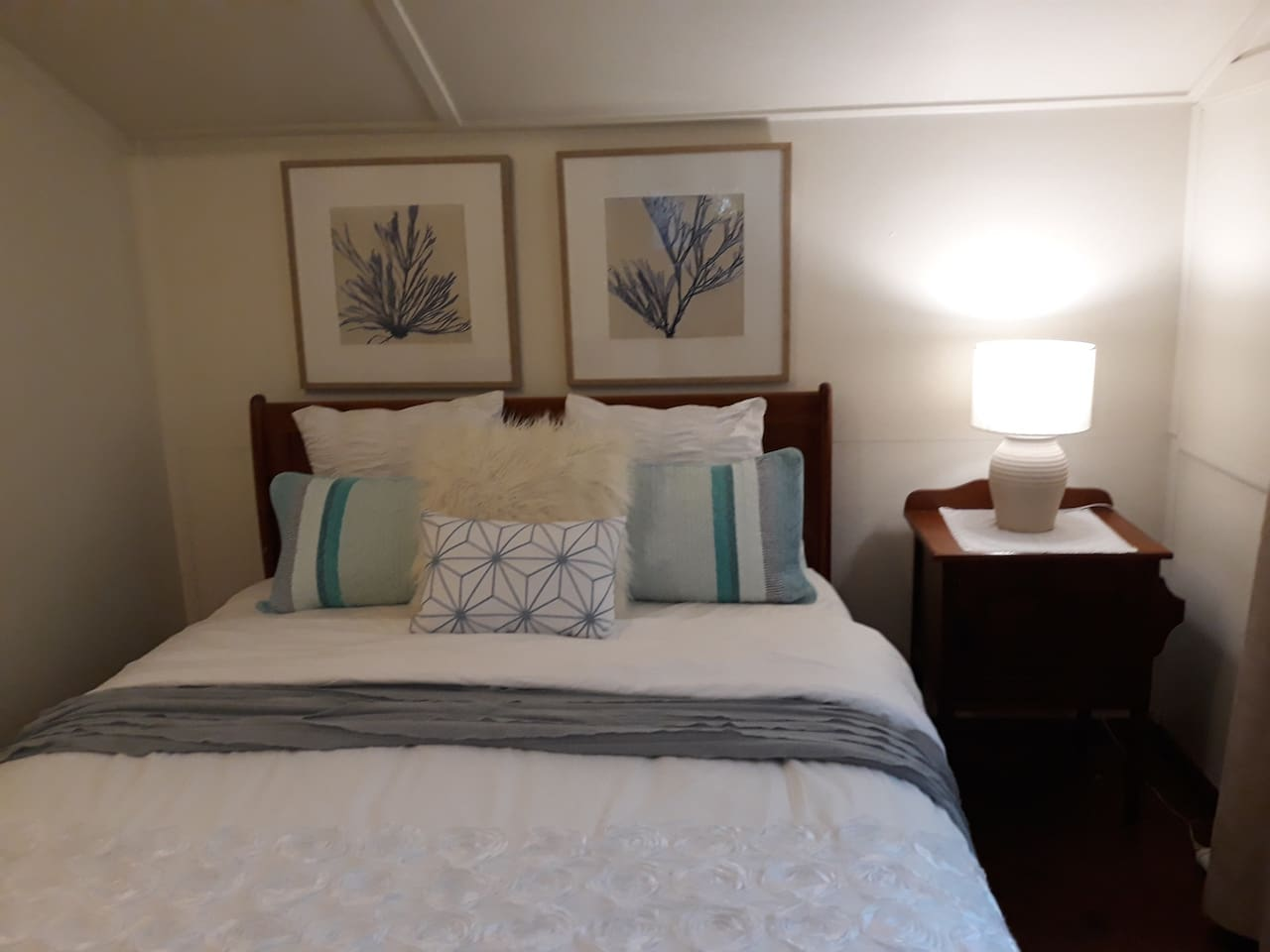 Comfy King sized bed with quality linens.