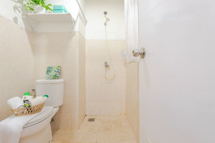 Compact & clean bathroom. We just put hot water shower for guest to enjoy!
