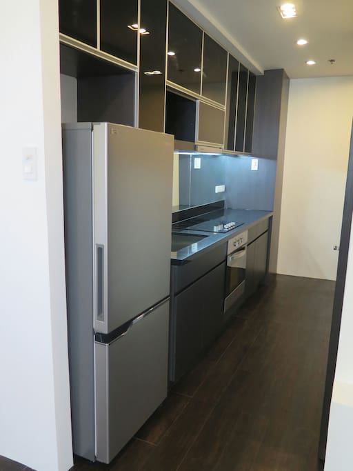 A fully equipped kitchen with Italian brand stove top, oven & rangehood