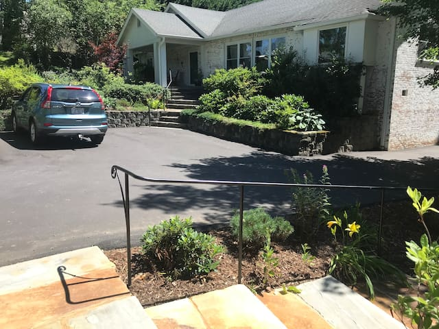 Guests can share the parking area in front of our home, a few steps from the cottage stairs.