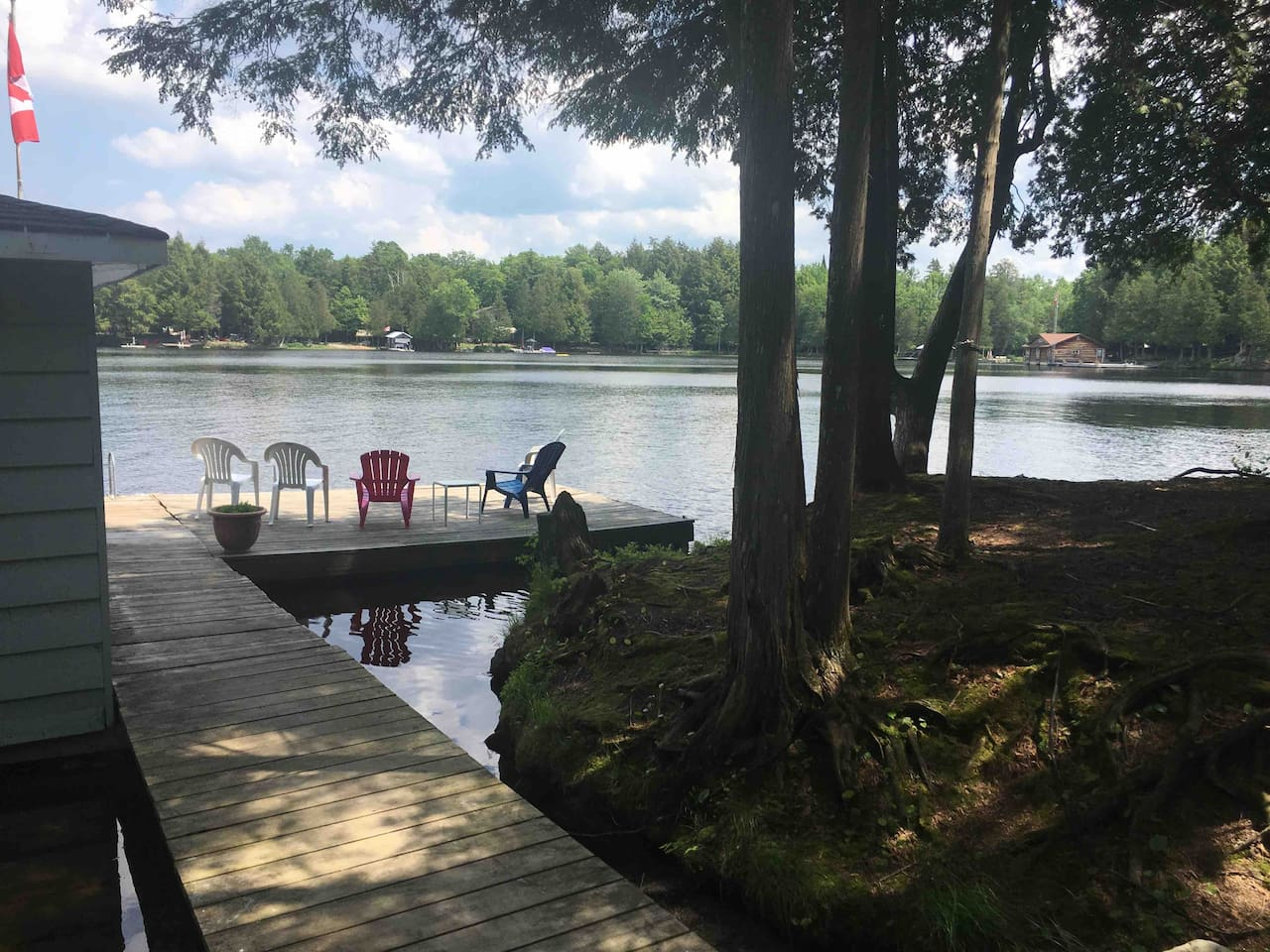 View of the dock with Muskoka chairs