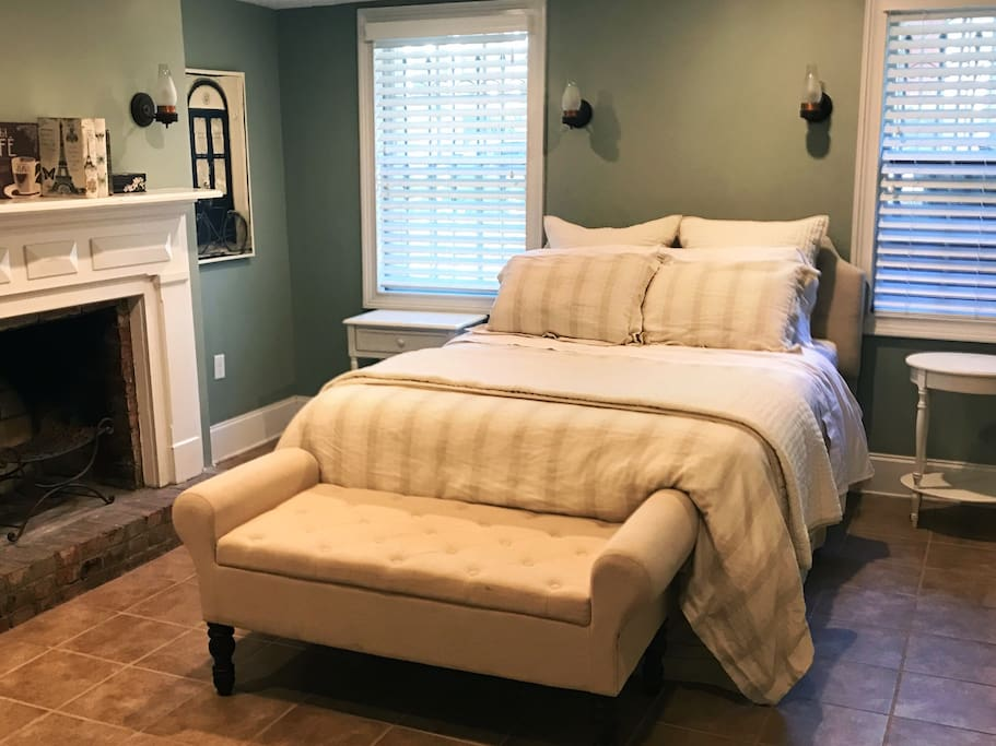 Primary bedroom with queen sized bed with luxury linens and silky-soft eucalyptus sheets. Room includes a desk in case a bit of work needs to done.