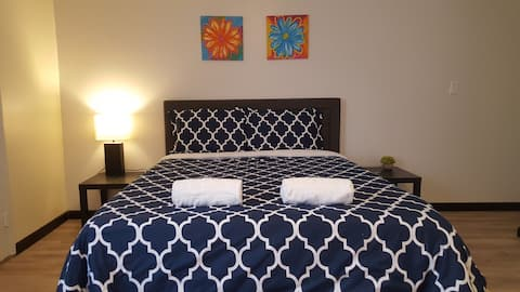 Master bedroom with queen size bed and memory foam mattress.