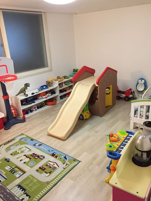 Our son's room--currently has a kids' single mattress on the floor...and a LOT of toys!