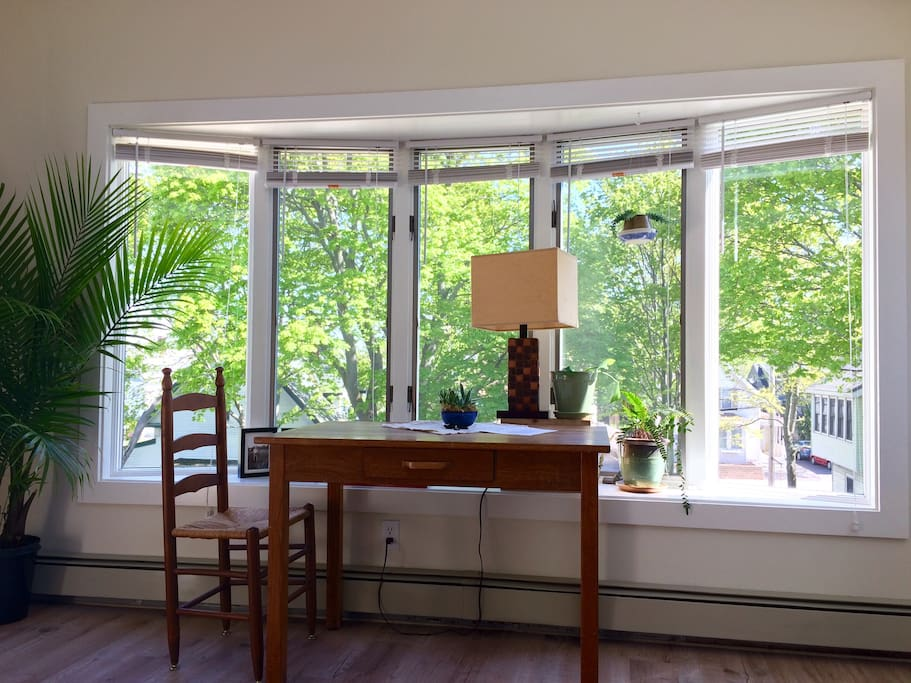 Full bay windows eat-in kitchen. Dining table doubles as a desk and workspace overlooking the yard.