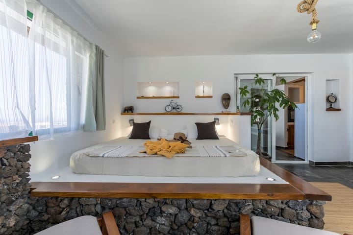 Very bright room with a big double bed.