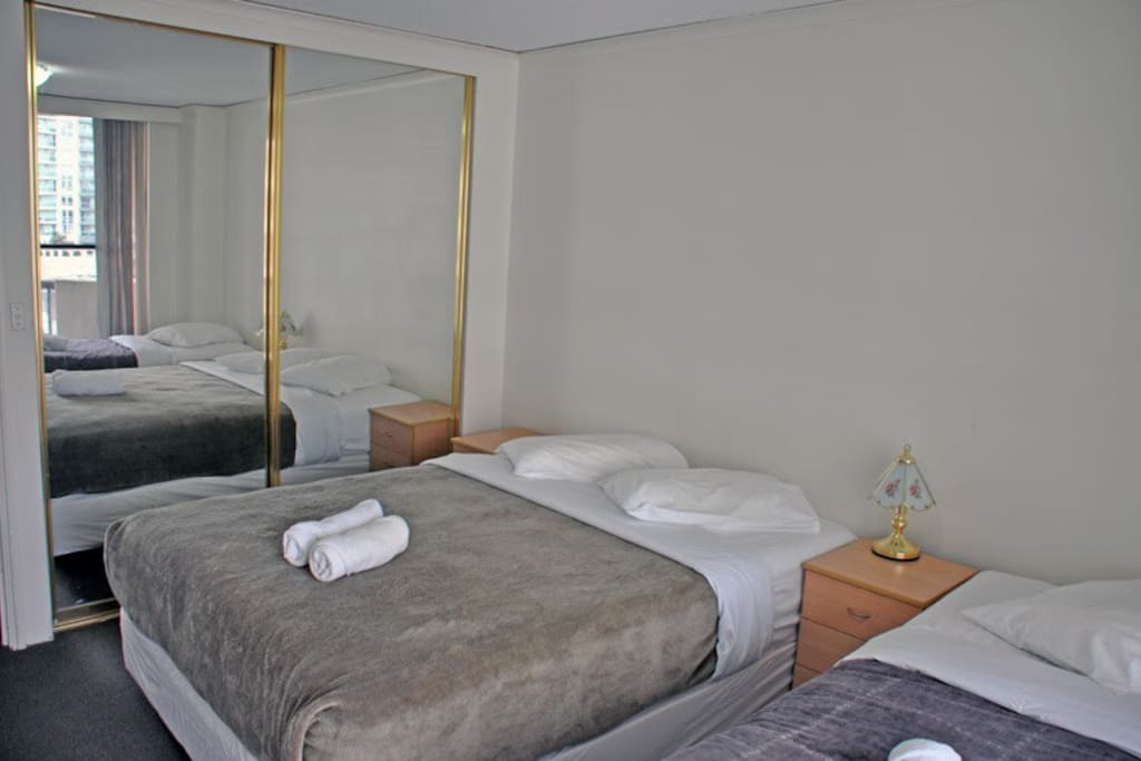 Main bedroom with queen and single beds