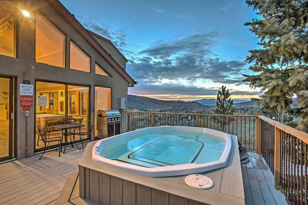 Situated in the Ridgecrest community, this home grants you access to community amenities, like this hot tub that looks out at the mountains.