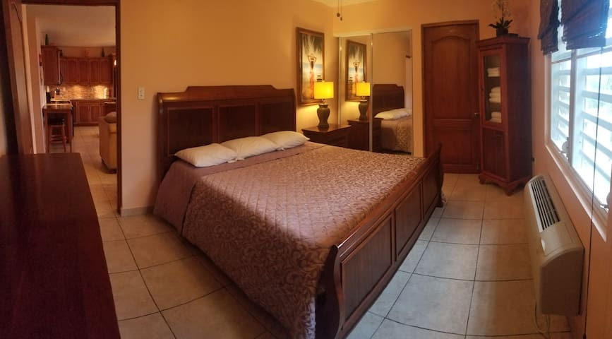 2nd floor bedroom with king bed  and private bathroom