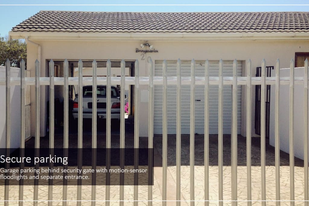 Secure parking. Garage parking behind security gate with motion-sensor floodlights and separate entrance.