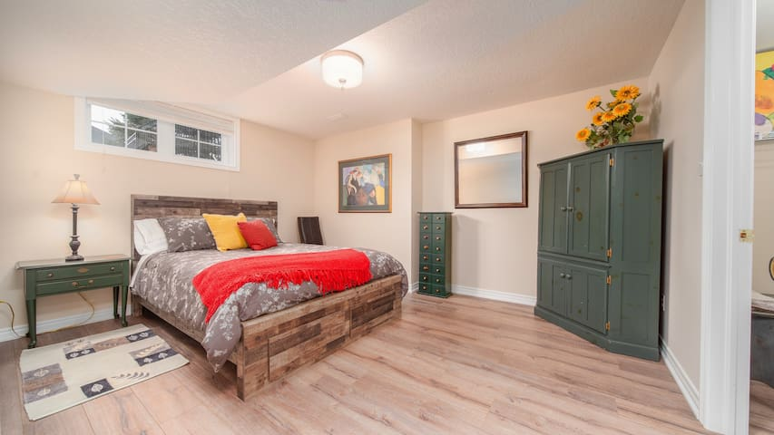 Larger bedroom with a comfy bed and a walk-in closet! You will sleep well in this comfortable country retreat.