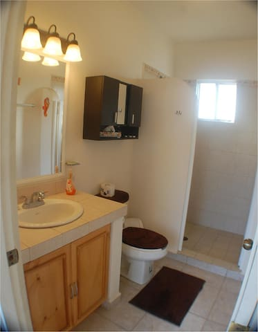 Bathroom is beautifully tiled and clean, with hot shower and toilet.