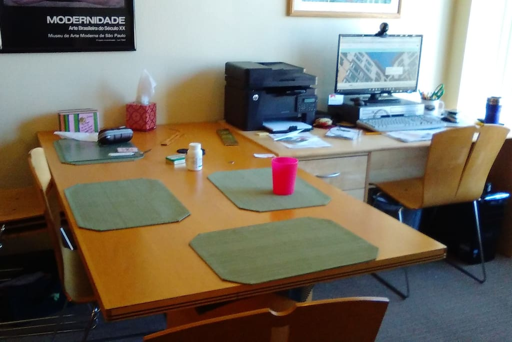 This is the office with a table for your laptop and a desktop PC and black and white laser printer if I'm not using it. The place is clean, and what you see here is the typical amount of clutter while I'm working.