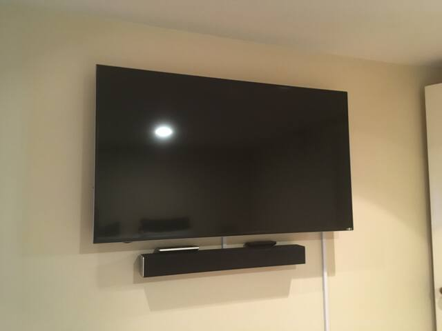 """55"""" Smart TV located in the bedroom. Use your own subscription to Netflix, Sling TV, or Roku for personalized channels."""