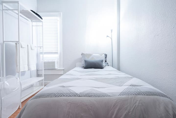 Relax in this studio bedroom. Bedding may change as we update our units regularly.