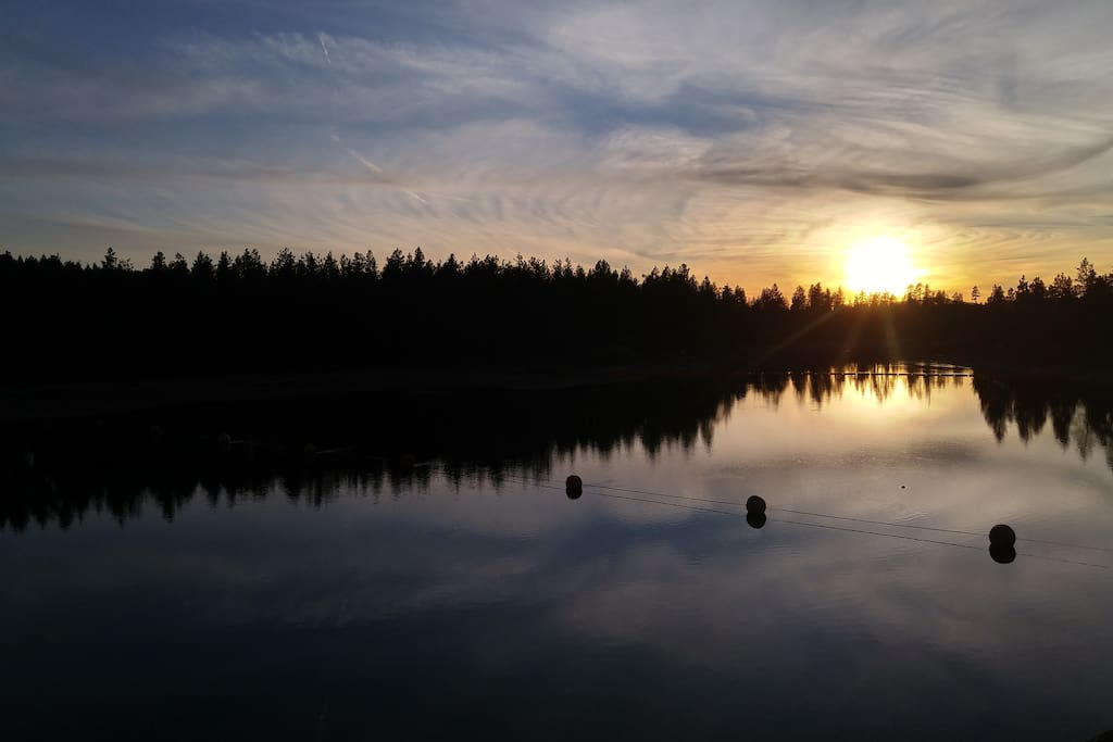 Sunset over Spokane River looking off deck.
