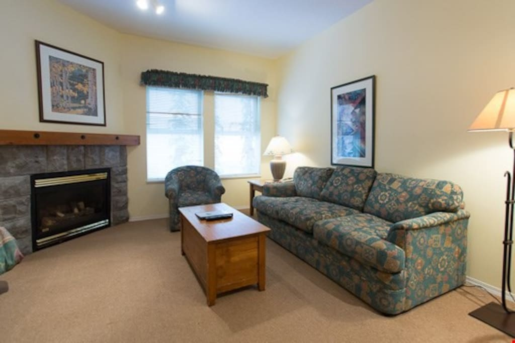 After a day on the hill, relax in the spacious living area with fireplace.