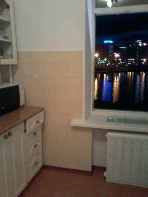 Вид из окна кухни ,с отражением  в реке зданий по пр.Победителей.