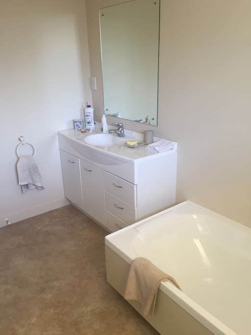Bathroom with bath & shower cabinet, separate toilet.