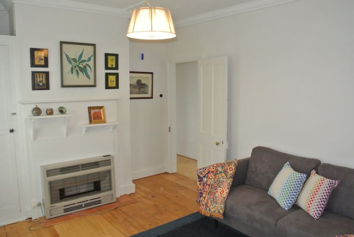 Living room with the original oregon floor boards