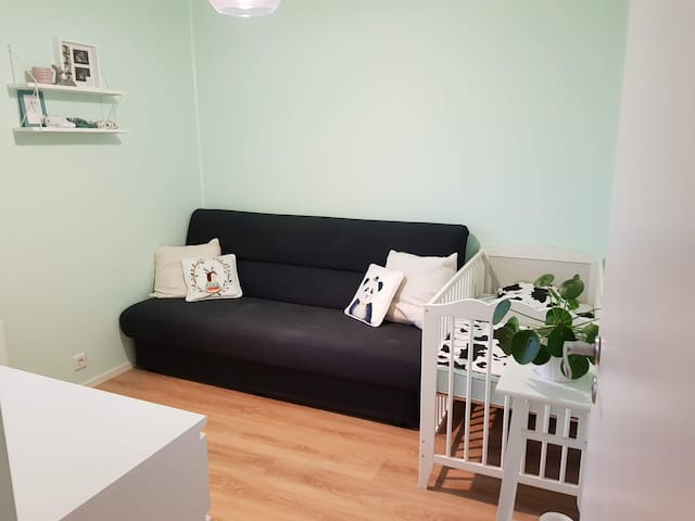 Bedroom 2: Sofa bed and crib