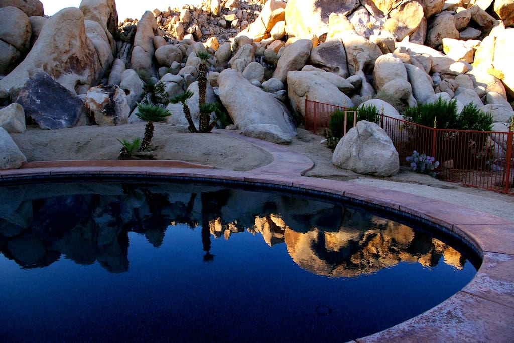 Reflections of boulders in the salt water pool.
