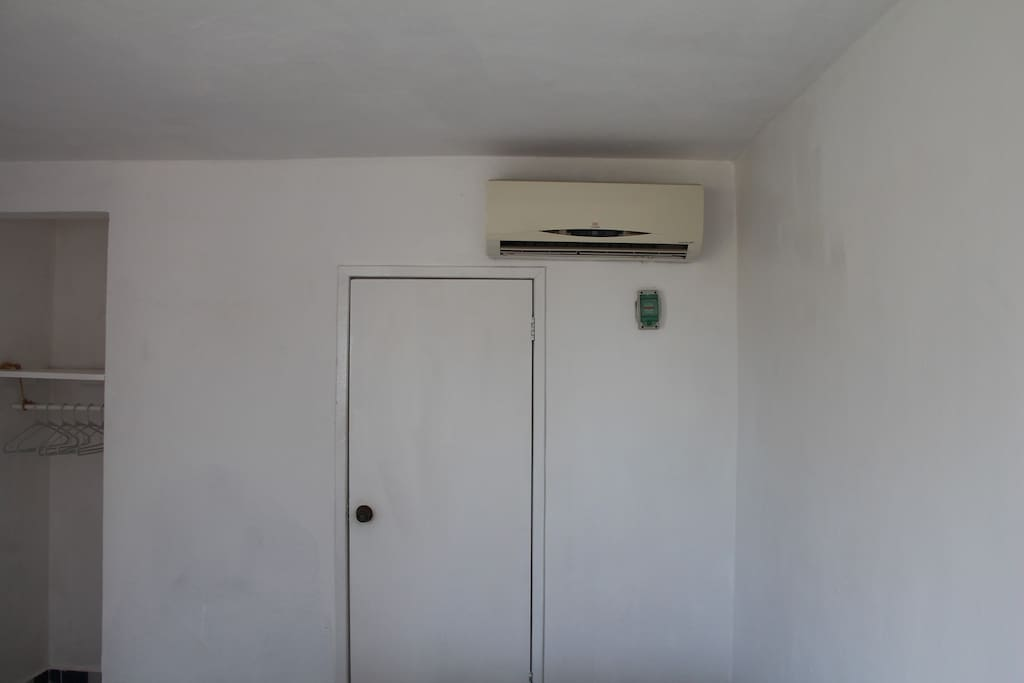 Air conditioner, hangers and bathroom door