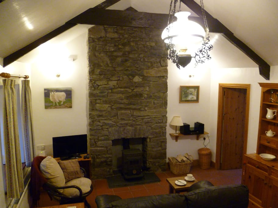 Charming character sitting room with cosy log burner
