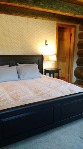 Master bedroom with King bed and master bath