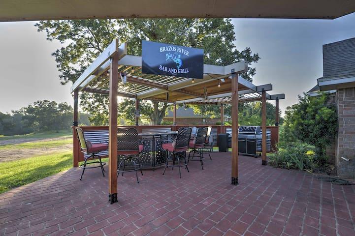 Beautiful pecan trees surround the spacious patio in the backyard.