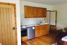 Kitchen space equipped with cooker, fridge and microwave. All cooking essentials provided.