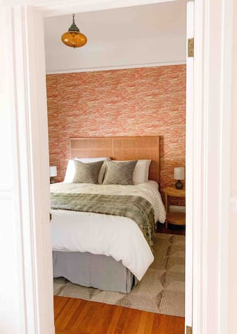 Cozy bedroom on main level with queen bed