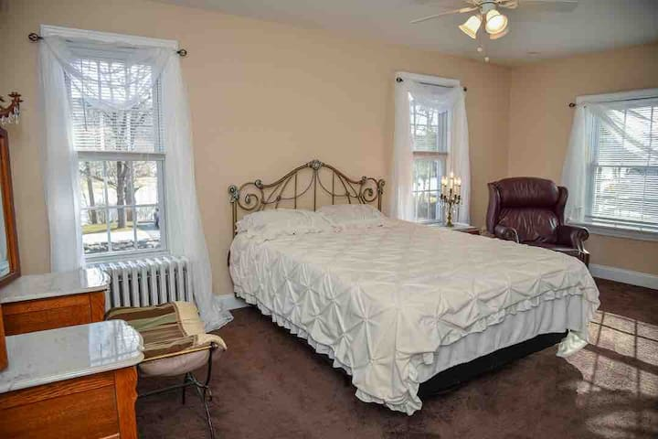 The mocha room has a queen size bed and a personal vanity. This bedroom has river views.