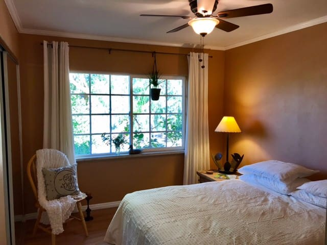 Bedroom 1 Queen Bed  Ceiling fan  Garden views
