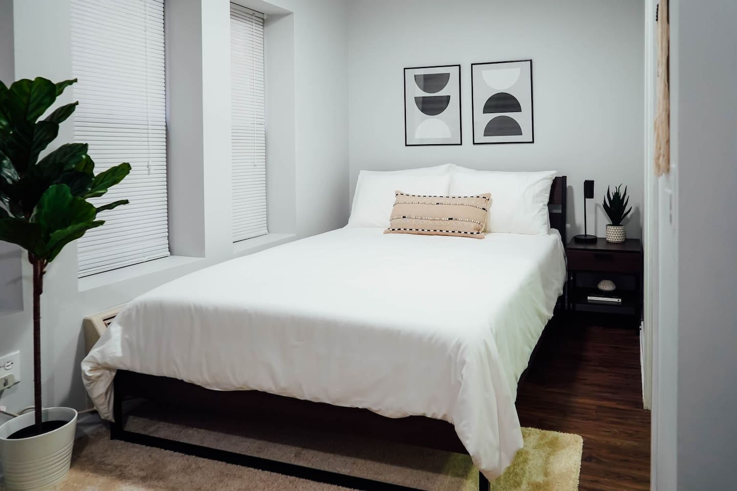 Queen sized bed with premium mattress, pillows and clean sheets