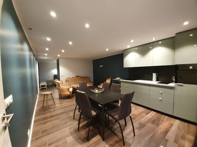 The Spa apartment is fully equipped with a modern kitchen that can easily sit six people.