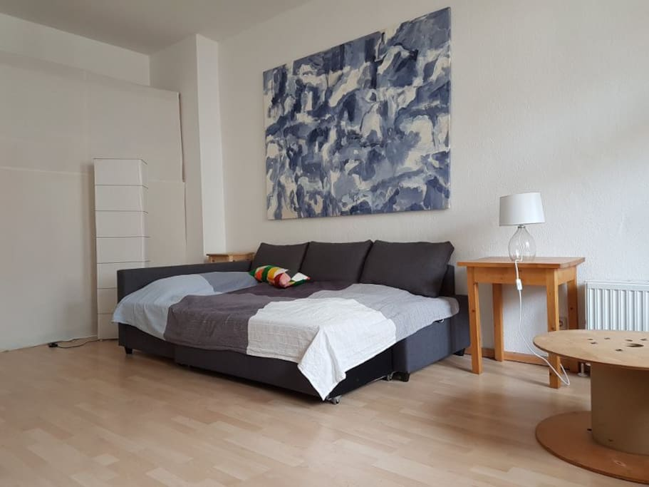 The bed and one of my paintings