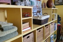 Baskets and shelving for items plus Walk-in closet (not shown)