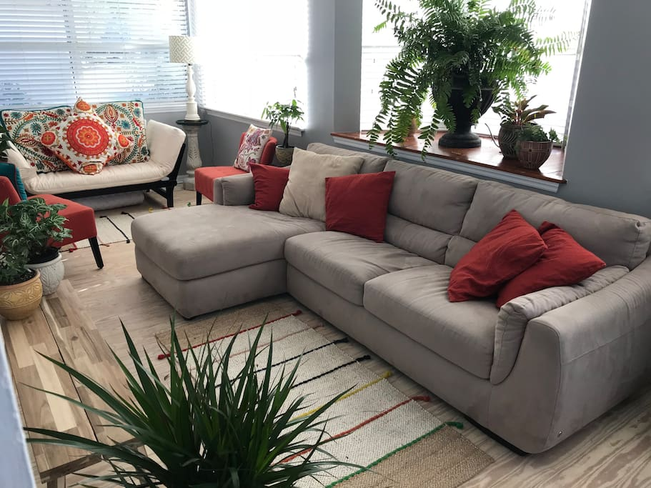 This is the sunroom, which is like a second living room. Great for large groups because there are two areas to sit on sofas and hang out. The white loveseat in the back of the photo also converts to a single bed.