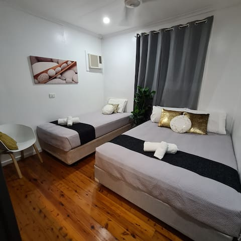 2nd Bedroom - Queen and King Single Beds