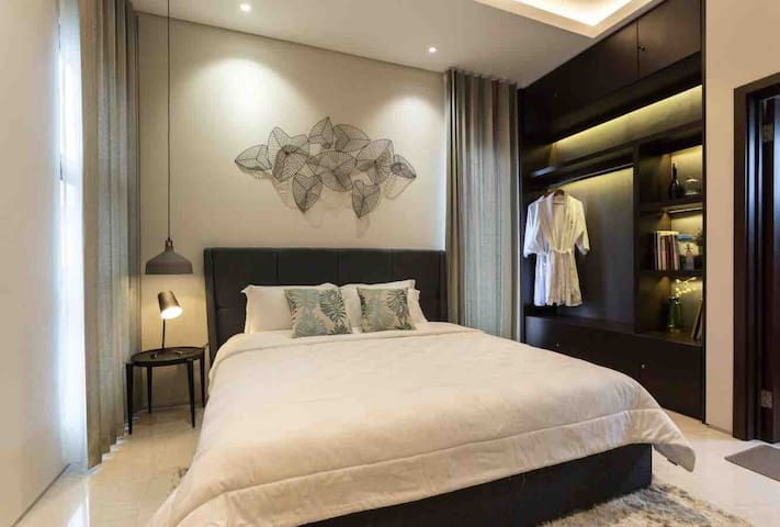 Master bedroom with king size bed and hotel-quality bedding. Air conditioner is provided in master bedroom.