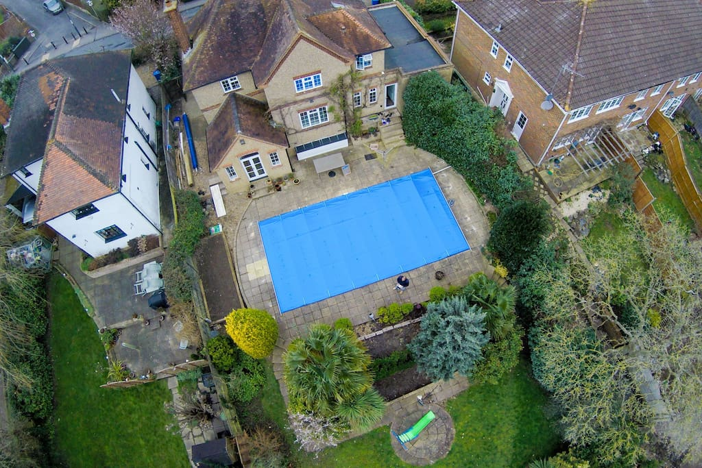 Drone view of Keiray Cottage, pool and back garden