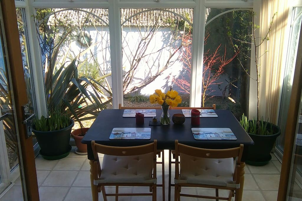 The conservatory (used as a dining space and available to guests)