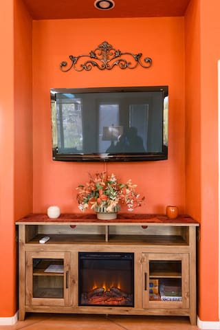 HD TV with Direct TV, WIFI and Electric fireplace